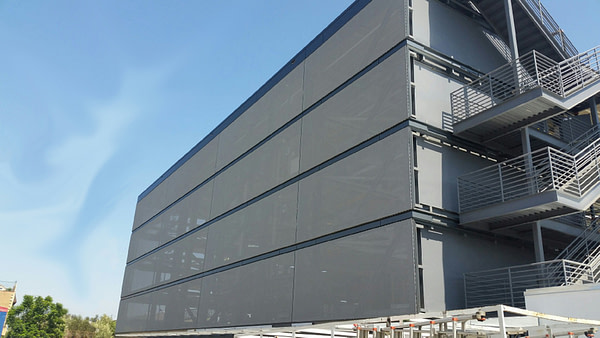 tensile facade system on parking garage