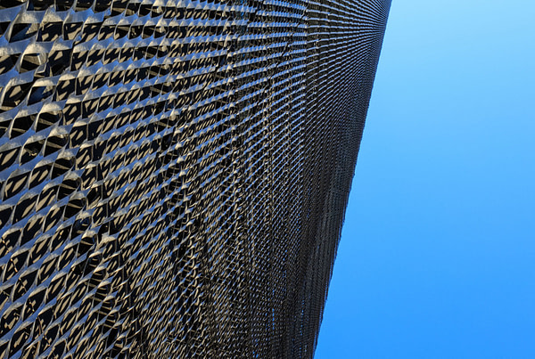 Why Choose Tensile Membrane Facades over Metal Mesh or Perforated Metal Facades